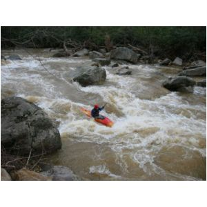 Bob Maxey hitting the main hole in the big South Fork rapid (Photo by Lou Campagna - 4/26/04)