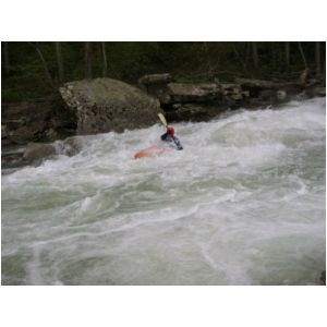 Bob Maxey finishing Bridge Rapid (Photo by Scott Gravatt - 4/27/04)