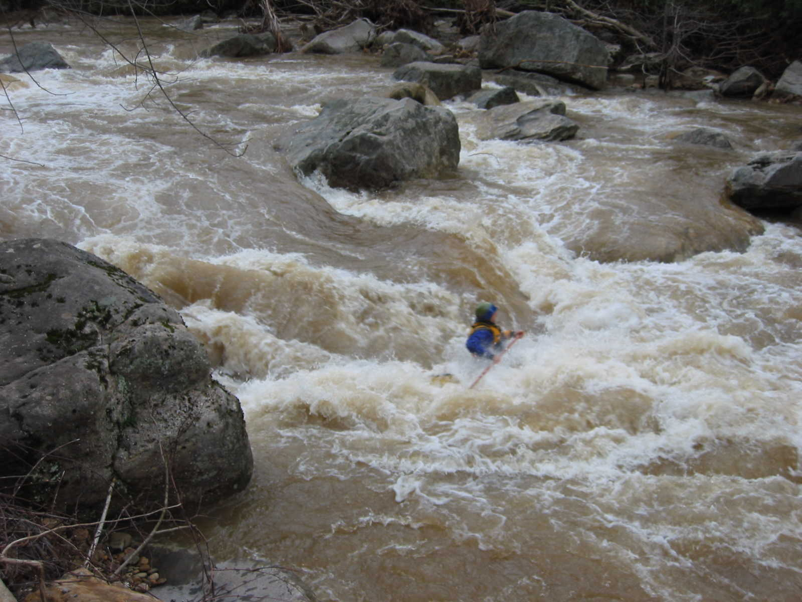 Jim Pruitt burying canoe in main hole of the big South Fork rapid (Photo by Lou Campagna - 4/26/04)