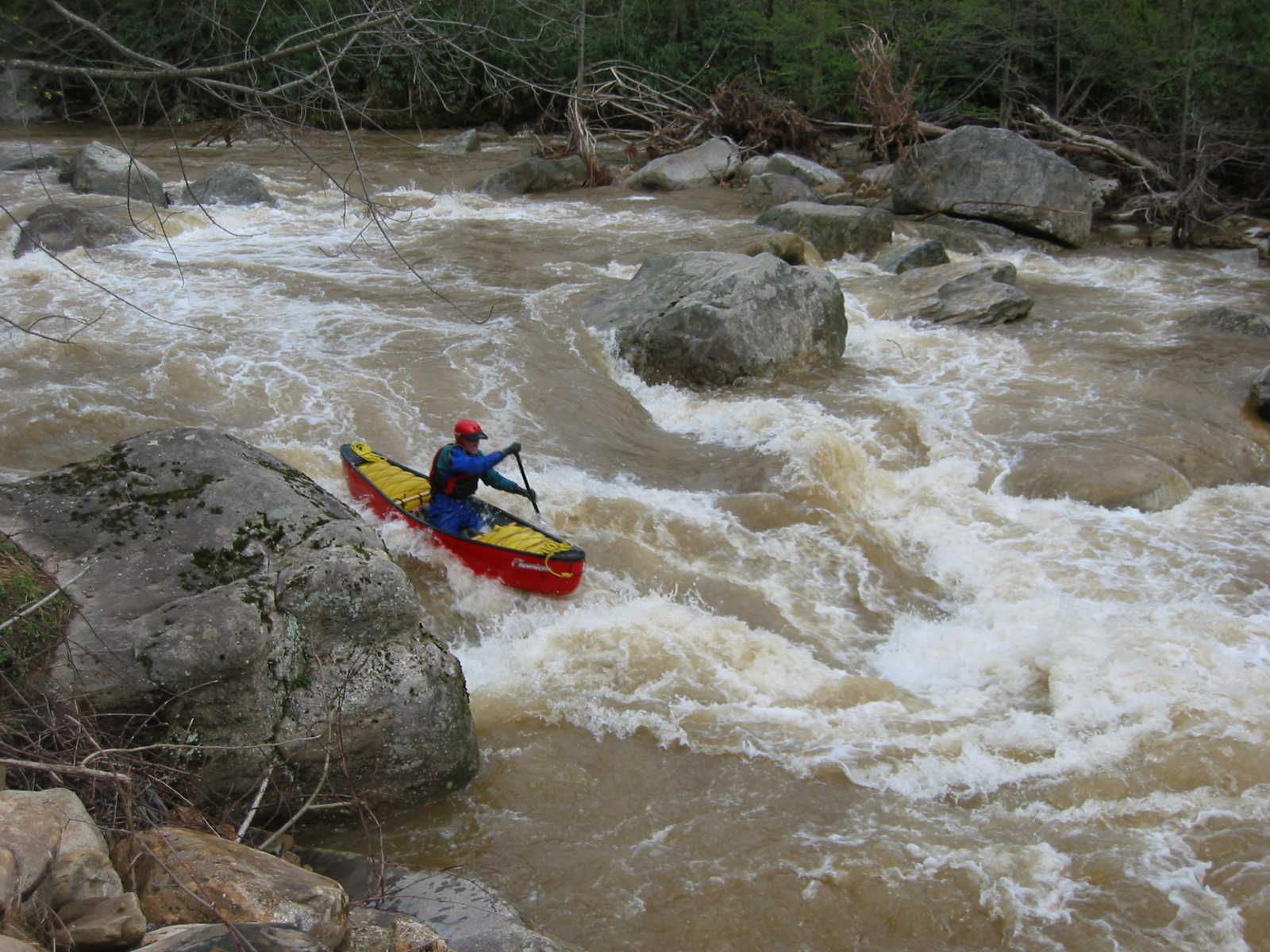 Scott Gravatt trying to avoid main hole in the big South Fork rapid (Photo by Lou Campagna - 4/26/04)