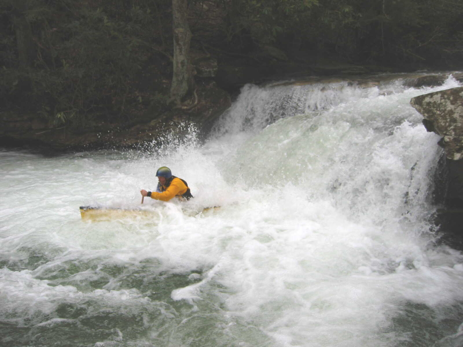Jim Pruitt running Sugar Creek ledge (Photo by Scott Gravatt - 4/27/04)