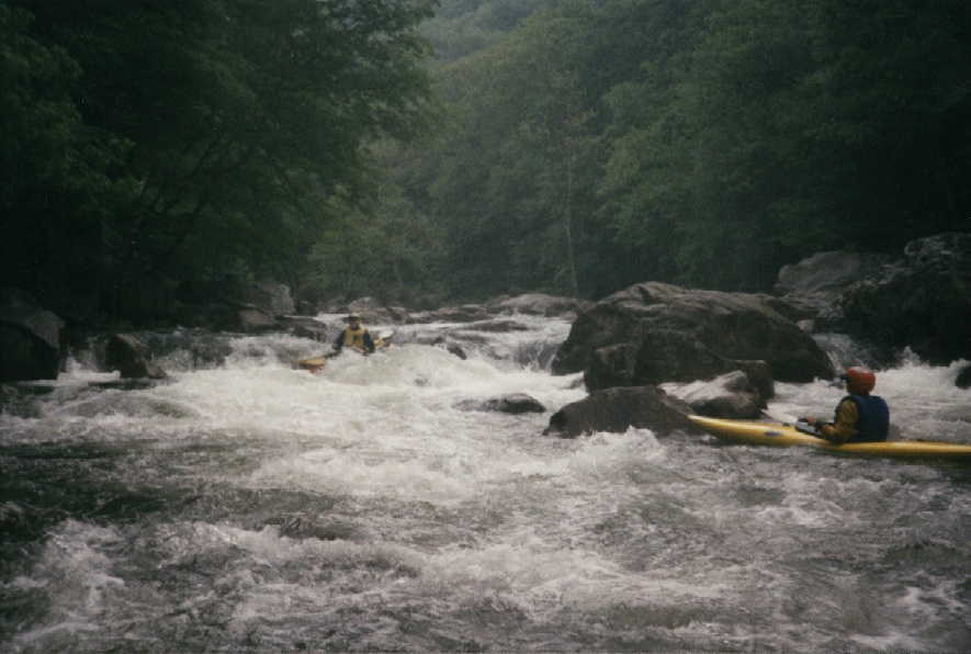 Kim Buttleman running Island Rapid on the Lower Big Sandy @5.4', Keith Merkel in eddy (in 1997)