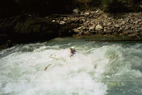 Cahil Converse in rapid entering mini-canyon (where's the Class IV rapid?) (Photo by Keith Merkel - 7/5/99)