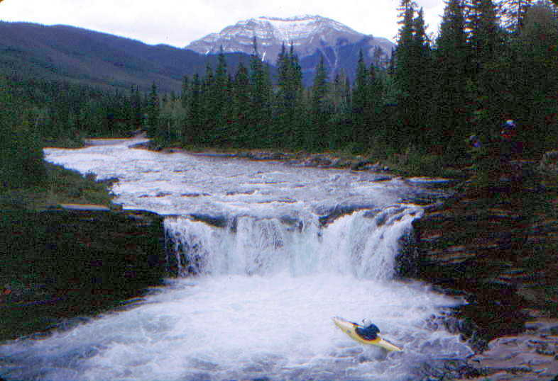 Keith Merkel looking up at Sheep Falls with beatiful Canadian Rockies scenery (Photo by Bob Maxey - 6/28/99)