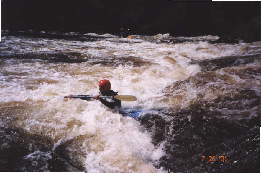 Bob Maxey continuing down Island Rapid (Photo by Keith Merkel - 7/26/01)