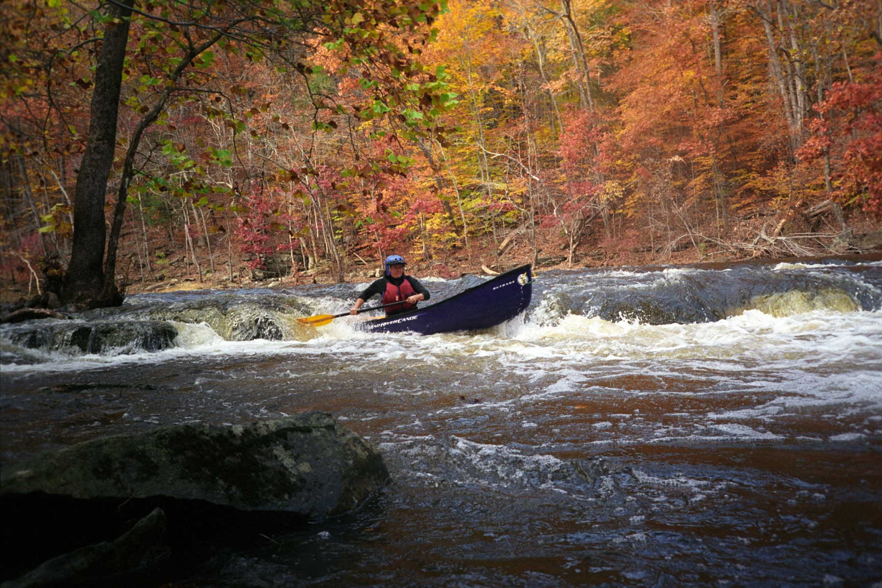 Angie Sigmund paddling the first ledge (Photo by Beth Koller - 11/5/05)